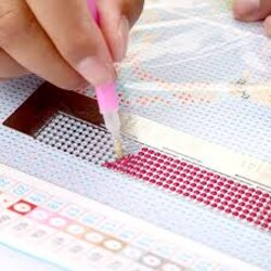 Инструмент за фиксиране на диамантчетата при лепене